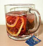 gelová svíčka s čaj. sáčkem,suš.citrónem a šípky